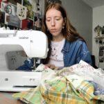 Fashion Designer Erin Williams at work with her sewing machine